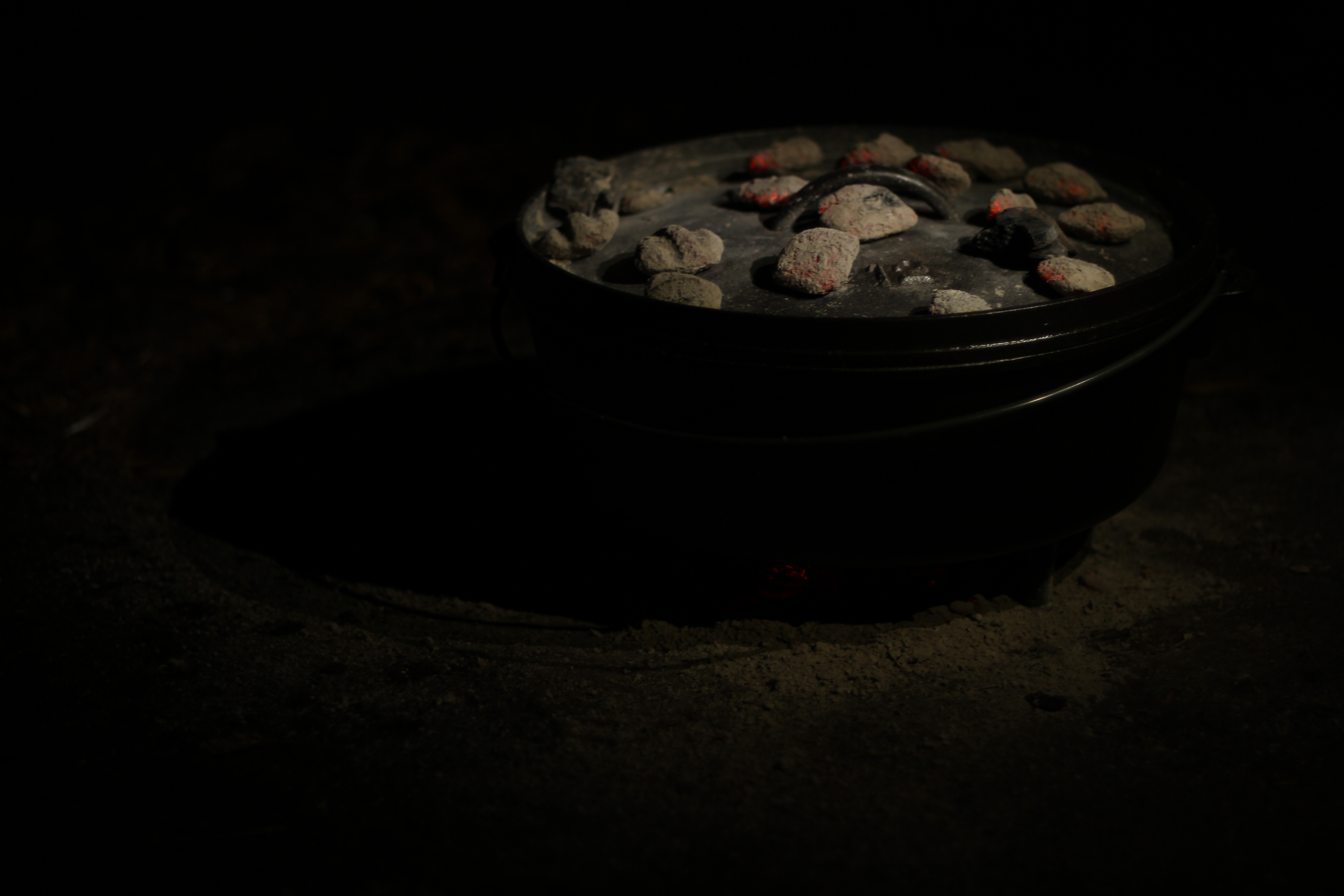 Camping recipe: cooking Spicy sweet potato stew and biscuits in the dutch oven
